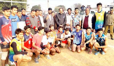 Winners of Volleyball Tournament posing along with former Minister Surjeet Singh Slathia.