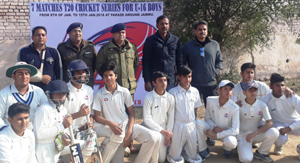 Budding cricketers posing for a group photograph at Parade Ground in Jammu.