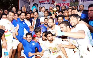 Winners of Christmas Gold Cup Football Tournament posing along with the chief guest and other dignitaries in Jammu.