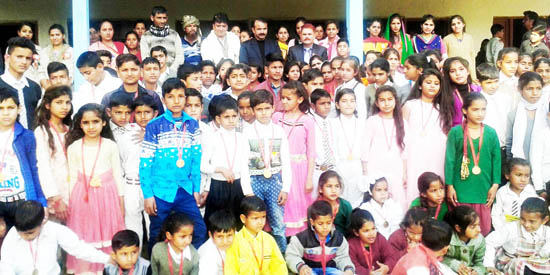 Students posing along with dignitaries during Annual Day celebration of Amar Jyoti Public School in Udhampur.