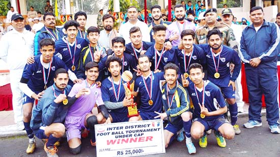 Young footballers posing along with Minister for Forest, Ch Lal Singh at BSF Stadium, Paloura in Jammu.