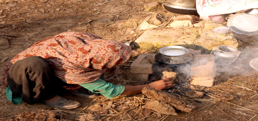 A village woman uses traditional 'Chulla' to boil milk on the outskirts of Jammu. —Excelsior/Rakesh