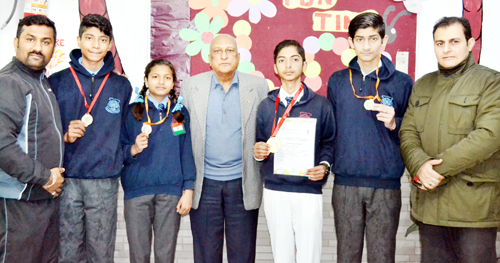 Medal winners of Lawrence School posing for a group photograph during felicitation function.