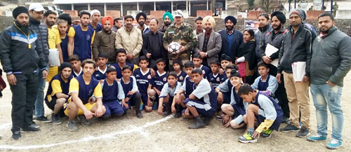Young footballers posing along with dignitaries and officials in Poonch.