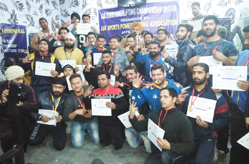 Medal winners of State Federation Cup, Bench Press and Deadlift Powerlifting Championship posing for a group photograph.