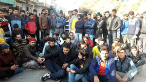 People protesting at Kheora in Rajouri on Sunday. — Excelsior Bhat