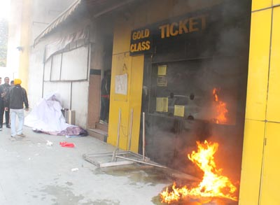 A portion of cinema hall set on fire by protesters at Jammu on Wednesday. —Excelsior/Rakesh