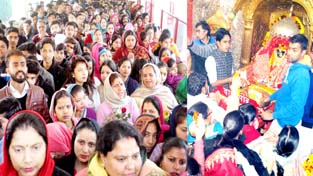 Devotees waiting for their turn to pay obeisance at Bawe Wali Mata temple at Jammu on Monday. -Excelsior/Rakesh