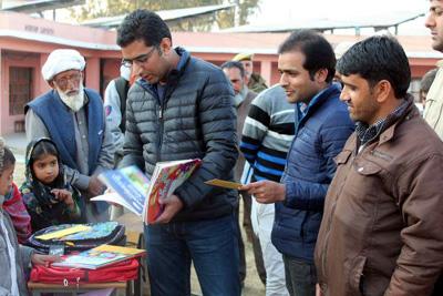 Deputy Commissioner Rajouri Shahid Iqbal Choudhary giving stationery to students on Saturday.