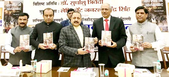 """Union Minister Dr Jitendra Singh, flanked by BJP National Spokesperson Sudhanshu Trivedi and Lt. General Narendra Singh, releasing a book on """"Kashmir Terrorism"""" written by Major Saras Tripathi at Constitution Club, New Delhi on Saturday."""