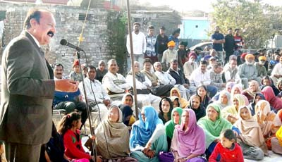 Former Minister and senior NC leader Surjeet Singh Slathia addressing a gathering at Ramgarh in Samba.