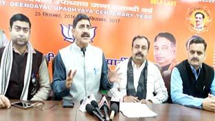 MP, Jugal Kishore Sharma & MLC Ch. Vikram Randhawa at a press conference at BJP office at Trikuta Nagar on Sunday.