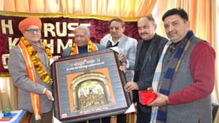 President Dharmarth Trust honouring those contributing to Raghunath temple.