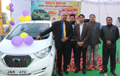 BPCL officials, Rajesh Sharma and Mayank, along with other guests during a function to announce mega lucky draw at M/s Aar Kay Filling Station, Kathua.