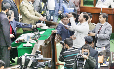Banihal and Udhampur MLAs arguing with Speaker from the Well of Legislative Assembly on Thursday. — Excelsior/Rakesh