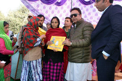 Food, Civil Supplies and Consumer Affairs Minister distributing free gas connections in Rajouri on Saturday.