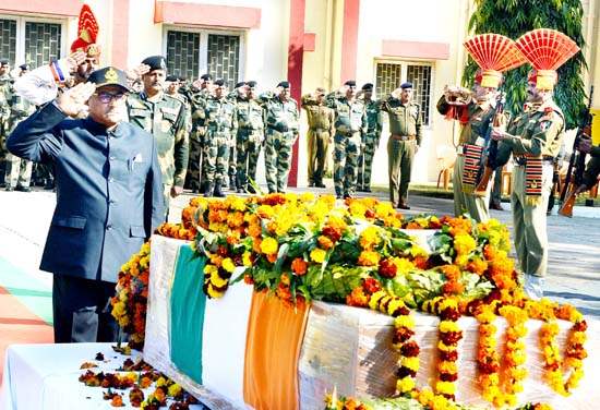 Deputy Chief Minister Dr Nirmal Singh paying tribute to martyred border guard at Frontier Headquarters BSF Jammu on Saturday.