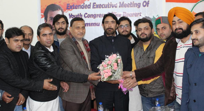 PCC chief GA Mir and senior leader Sham Lal being felicitated at PYC convention in Jammu on Thursday.
