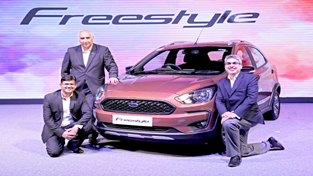 Officials of Ford India unveiling Ford Freestyle Compact Utility Vehicle in India.