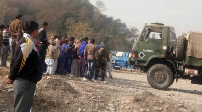 Villagers restricting the Army from practicing at Kalith Firing Range in Khour tehsil of Jammu on Thursday.