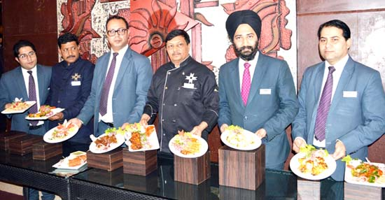 """Chefs showing cuisines to be served to the people during food festival """"Kebabs for Nawabs"""". -Excelsior/Rakesh"""