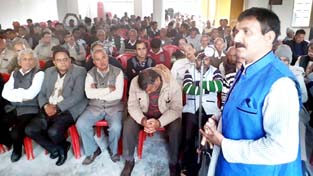 Senior Cong leader Dr Manohar Lal Sharma addressing party workers at Hiranagar.