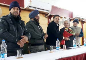 Members of Halwai Association of Jammu presenting bouquet to Dr Parvesh Kumar, Assistant Commissioner Food Safety Jammu during a workshop at Jammu on Wednesday.