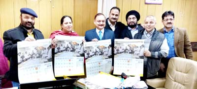 Minister for Health, Bali Bhagat and others releasing a calendar of Health Department on Friday.