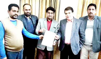 VC, SC, ST, BC Development Corporation, Balbir Ram handing over loan letter to a SC unemployed youth along with Corporation MD, RK Pandita at Jammu on Friday.