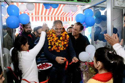 Speaker Legislative Assembly Kavinder Gupta inaugurating a restaurant in Jammu.