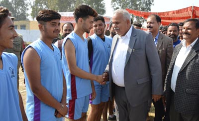 Minister for PHE, Sham Lal Choudhary interacting with players while declaring open Volleyball Tournament on Tuesday.