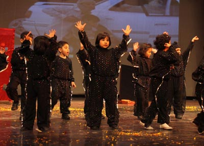 Children presenting cultural item while celebrating Founder's Day at Abhinav Theatre in Jammu.