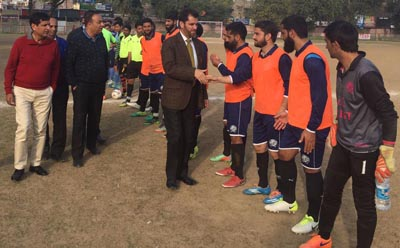 Chief guest and other dignitaries interacting with the players during a match of 1st Maharaja Memorial Gold Cup Football Tournament in Jammu.