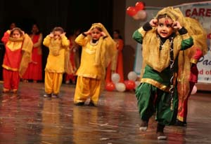 Children presenting dance item while celebrating Annual Day at Daffodils Care Convent Play Way School in Jammu.