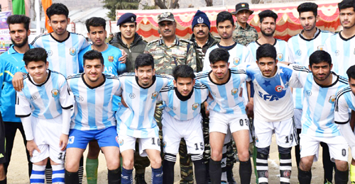 Winners of Football Tournament posing along with dignitaries in Baramulla.