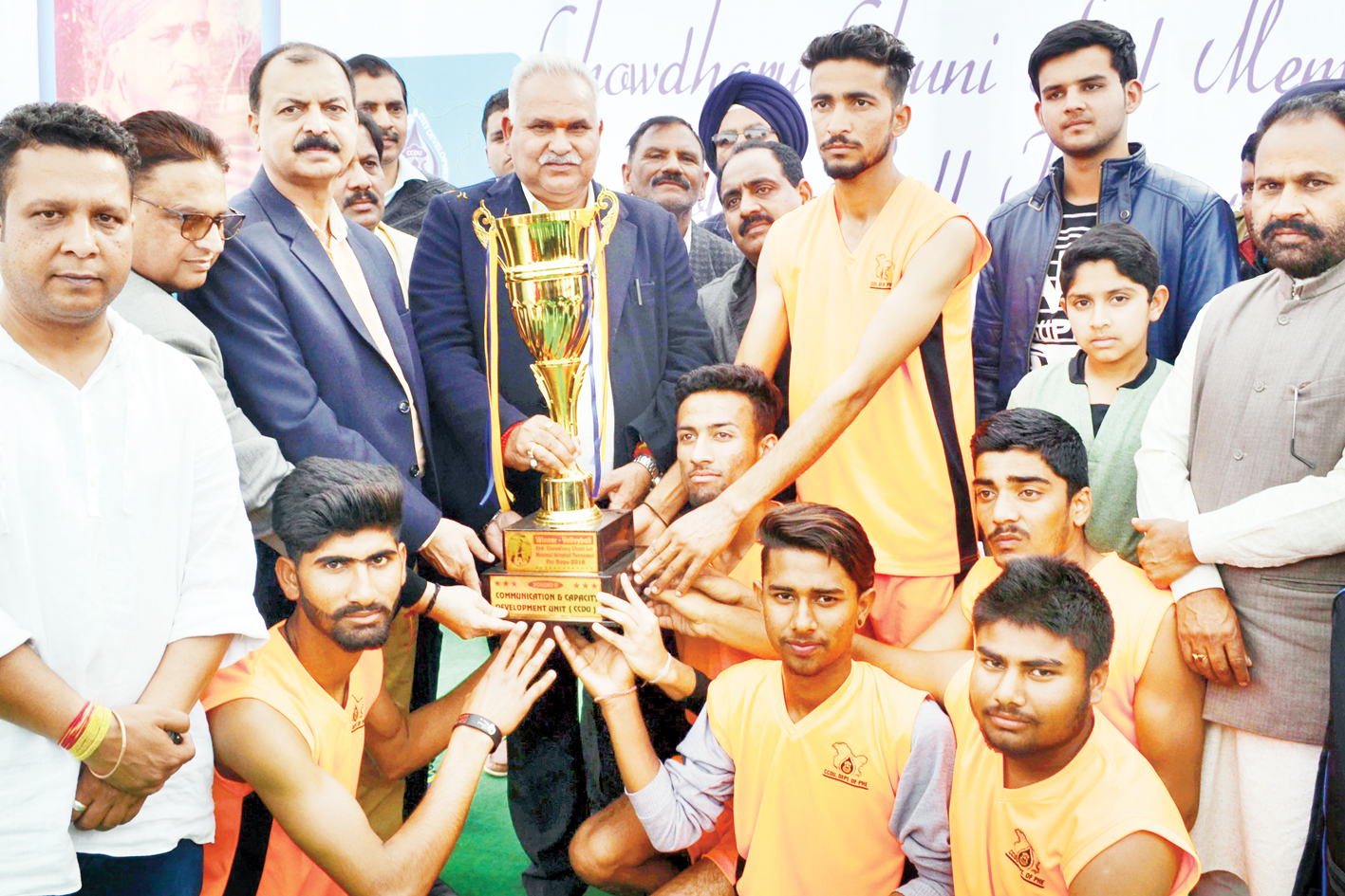 Winners of Volleyball Tournament holding trophy while posing for a group photograph along with Minister for PHE, Sham Choudhary in Jammu.