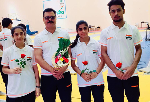 Shreya and Rudra along with Shotu Lal posing for a group photograph before leaving for Asian Cadet Fencing Championship.