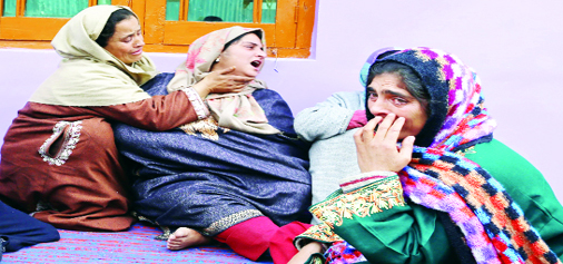 Family members of JCO Mohd Ashraf Mir wail after hearing the news of his death in their house at Maidanpora, Kupwara on Sunday. —Excelsior/Aabid Nabi