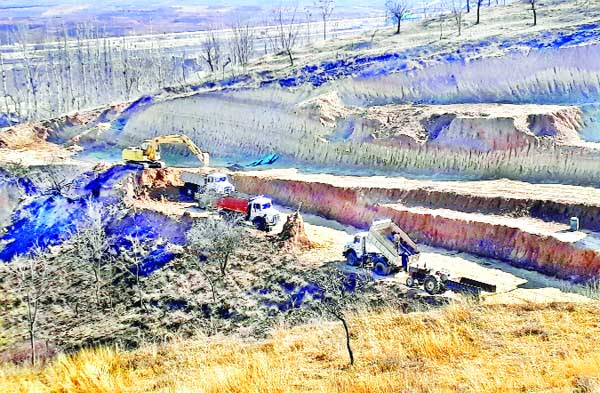 Despite Government ban, illegal soil extraction going on in many areas of Pulwama district. -Excelsior/Younis Khaliq