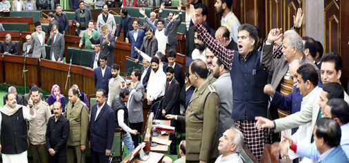Opposition and ruling BJP MLAs counter each other in the Assembly on Monday. -Excelsior/Rakesh
