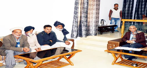 Dineshwar Sharma meeting a delegation in Poonch on Tuesday.