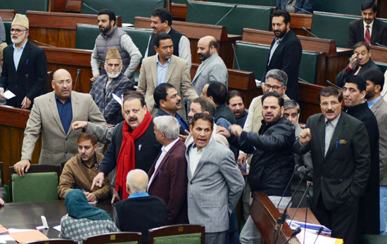 Opposition MLAs protesting in the Assembly against 'nepotism' in allotment of Fair Price shops. —Excelsior/Rakesh
