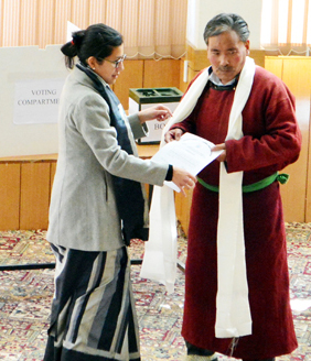 DC Leh Avny Lavasa handing over appointment letter to Dorjey Mutup in Leh on Monday. -Excelsior/Morup Stanzin