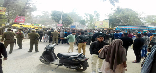 People protest, block Jammu-Poonch highway at Sunderbani on Friday.