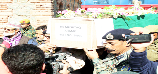 Senior police officers carrying coffin of head constable Mushtaq Ahmad during wreath laying ceremony at District Police Lines Srinagar on Tuesday. (UNI)
