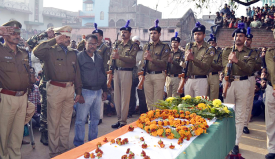 CRPF personnel pay gun salute to Constable Mujahid Khan, who was killed in an encounter in Srinagar's Karan Nagar, during his funeral at Piro in Bhojpur district of Bihar on Wednesday. (UNI)