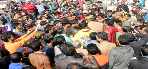 Stranded Kashmiri passengers protest at Jammu Bus Stand on Thursday.