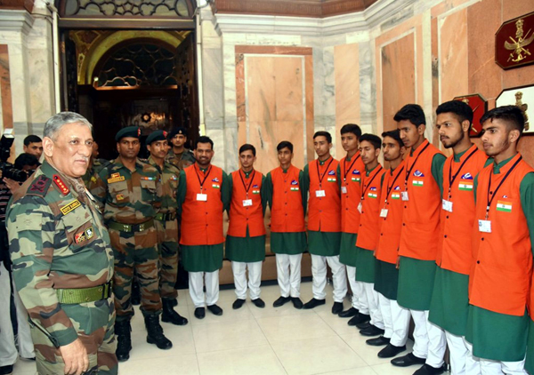 Army chief Gen Bipin Rawat with students from Rajouri in New Delhi on Friday.