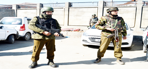 Security forces stand guard after militants opened fire at a police party inside a hospital in Srinagar on Tuesday. -Excelsior/Shakeel