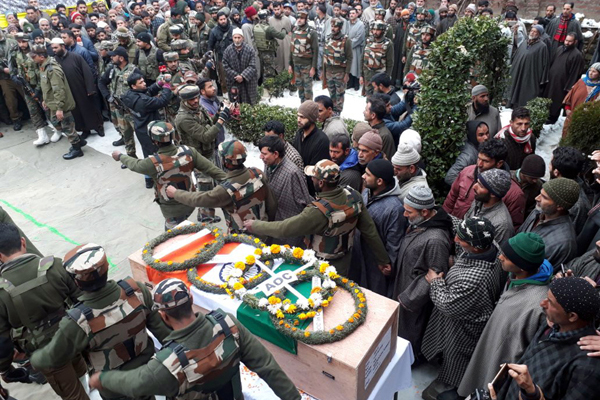 Troops and people pay tributes to Army martyr at Kewer, Qazigund in Anantnag district on Tuesday. -Excelsior/Sajad Dar